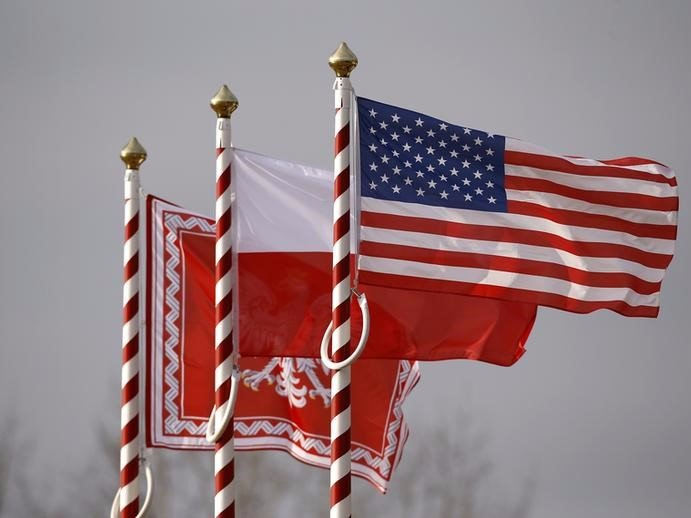 U.S., Poland's flags and jack of the President of Poland are seen during the inauguration ceremony of bilateral military training between U.S. and Polish troops in Zagan Thomson Reuters