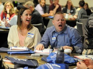 Photo By Zachary Mott | Jon Logan, right, a U.S. Army Reserve Soldier, and his wife Amy share a laugh