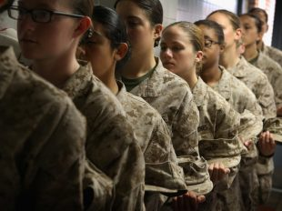 Marine recruits in line during boot camp on Parris Island, S.C., in 2013. An outdated New York Times article is being shared on social media to suggest that women are required to register for the draft. Credit Scott Olson/Getty Images