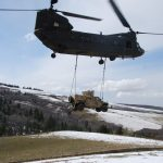 Maj. Christopher Lende A Montana Army National Guard CH-47 Chinook recovered a United States Air Force Humvee that was stuck for more than a week on a muddy Montana road.