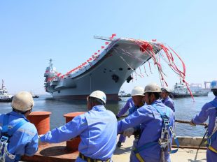 China's first domestically built aircraft carrier at its launching ceremony in Dalian, China, on Wednesday.