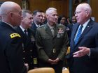 Sen. Patrick Leahy, D-Vt., talks with, left to right, Lt. Gen. Charles D. Luckey, chief of the Army Reserve; Vice Adm. Luke M. McCollum, chief of the Navy Reserve; and Lt. Gen. Rex C. McMillian, commander of Marine Corps Forces Reserve before a Senate Appropriations Subcommittee on Defense hearing on National Guard and Reserve programs and readiness, April 26, 2017 in Washington, D.C.