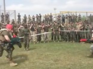 An airman takes on a Marine with pugil sticks