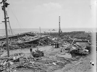 Site of the Port Chicago explosion in July 1944. Wreckage of the Quinault Victory is submerged in background. (UC Berkeley Bancroft Library)