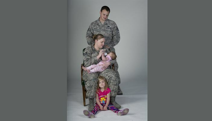 Air Force Staff Sgts. Kyle Leidholm of the 60th Aircraft Maintenance Squadron and Nicole Leidholm of 60th Air Mobility Wing Public Affairs pose for a family portrait at Travis Air Force Base, Calif., April 6, 2017. In addition to the challenges they face as individual service members, the couple must also contend with issues unique to dual-military couples. Air Force photo by Heide Couch