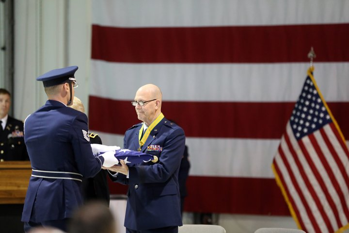 Brig. Gen. Brent Feick, outgoing director of joint staff for the Alaska National Guard, participates in a flag folding ceremony during his retirement ceremony at the National Guard armory on Joint Base Elmendorf-Richardson, Alaska, April 1, 2017. Feick retired after 41 years of service to our nation.