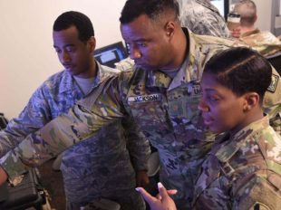 Senior Airman David Daniel of the Maryland National Guard's 275th Cyber Operations Squadron (right), Maj. Steven Jackson, the Mississippi National Guard's assistant intelligence officer (center) and Staff Sgt. Nyesha Bradley of the Louisiana National Guard's D Company, 769th Brigade Engineer Battalion (left) examine a screen showing information critical to their cyber-defensive roles in Exercise Cyber Shield 17 at Camp W.G. Williams in Bluffdale, Utah, April 1, 2017. Approximately 20 Louisiana Soldiers and Airmen are training with 850 other Guardsmen from over 42 states and territories, as well as the FBI, Department of Homeland Security and more than 30 non-government entities including Entergy, Lockheed Martin, Monsanto and Louisiana State University. (U.S. Army National Guard photo by Sgt. Garrett L. Dipuma)