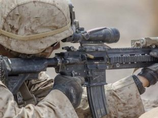A US Marine fires a M27 infantry automatic rifle at simulated enemies during an exercise, August 18, 2016.