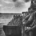 American servicemen climb into a military landing craft, known as a Higgins boat, at the end of their journey across the English Channel to join the fight to liberate France during World War II. (AP)