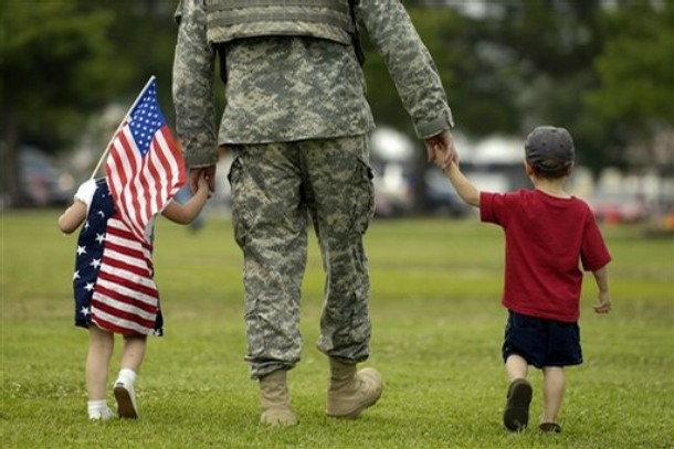 U.S. Army soldier with the 3rd Infantry Division walks with his children to pick up his duffle bag after a homecoming ceremony for about 265 soldiers with the Special Troops Battalion after a 15-month deployment to Iraq, Monday June 2, 2008 in Fort Stewart, Ga. The 3rd Infantry, which began sending troops home in March, was the first Army division called up for a third tour in Iraq.  (AP Photo/Stephen Morton)