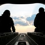 U.S. Army Sgt. 1st Class Roy Chandler, left, and Spc. Benjamin Grogan, assigned to Bravo Company, 1st Battalion, 169th Aviation Regiment, Alabama Army National Guard, sit on the tail of a CH-47 Chinook helicopter in route to deliver hay bales to cattle that have been stranded by Hurricane Harvey near Hampshire, Texas, Sep. 3, 2017. The Department of Defense is conducting Defense Support of Civil Authorities operations in response to the effects of Hurricane Harvey. DSCA operations are part of the DoD's response capability to assist civilian responders in saving lives, relieving human suffering and mitigating property damage in response to a catastrophic disaster. (U.S. Army photo by Spc. Dustin D. Biven)